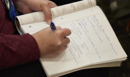 close-up shot of woman taking notes