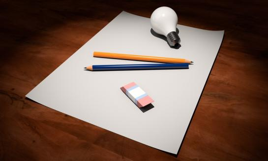 Image of pencil, eraser, and light bulb on blank sheet of paper