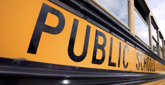 close-up shot of a yellow public school bus