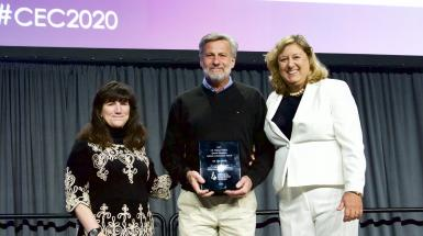 Three people on stage at CEC 2019
