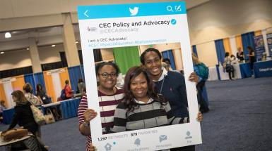 3 young adult members posing with CEC advocacy cut-out