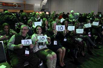 "Members of the CEC Board of Directors holding up ""10"" signs after the CEC 2020 Convention & Expo opening keynote"